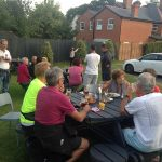 MAC members sitting around tables in Golden Ball pub garden